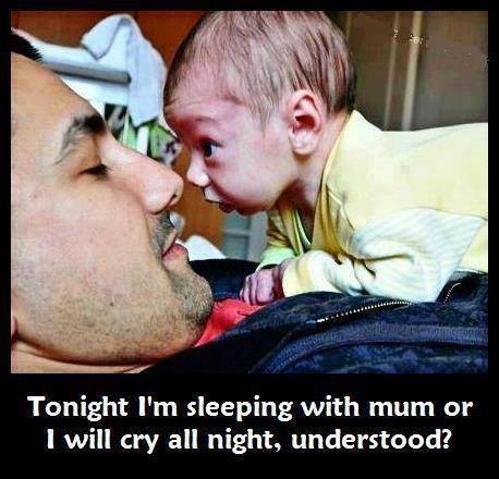funny-baby-and-father-sleeping-with-mom