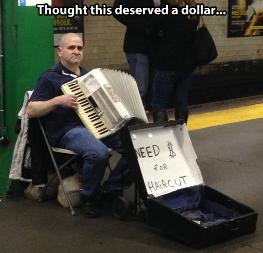 funny-picture-man-playing-accordion-bald