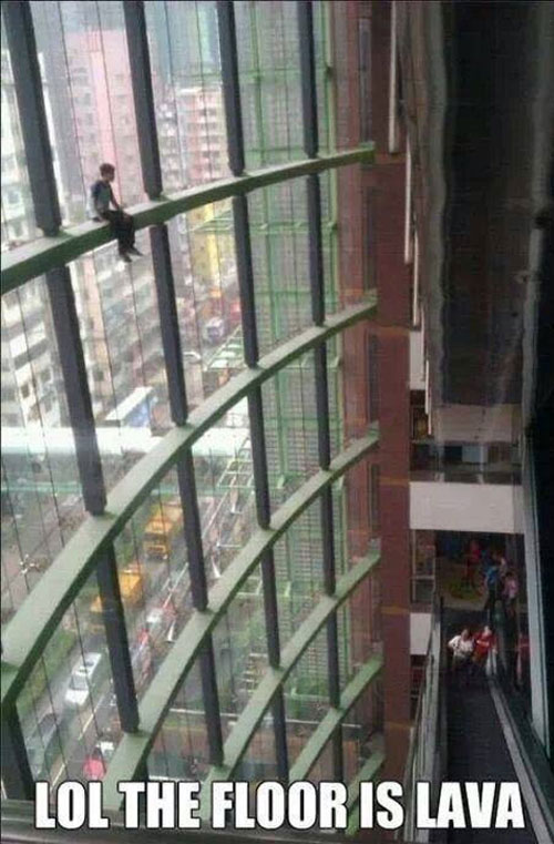 funny-picture-guy-shopping-mall-window-climbing