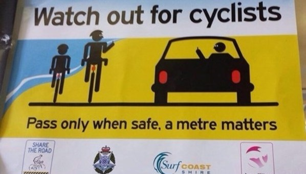 funny-picture-sign-watch-cyclists