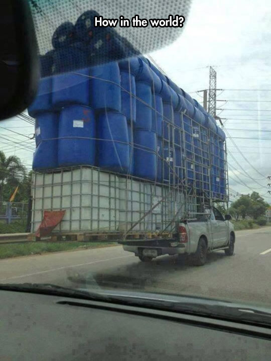 funny-picture-truck-carrying-water-tanks-physics