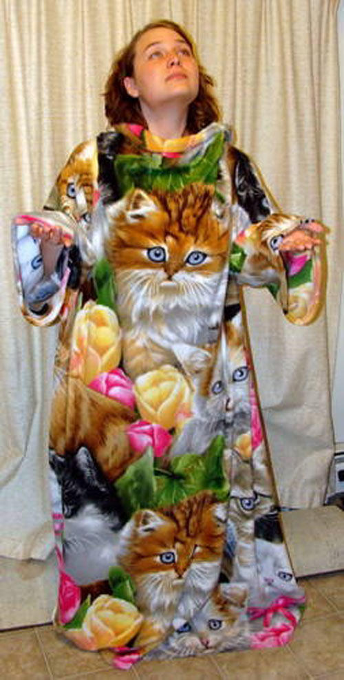 funny-picture-cat-snuggie-lady-flowers