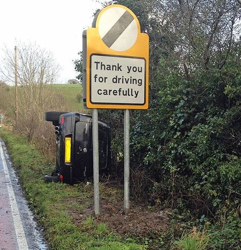funny-picture-driving-carefully-road-sign