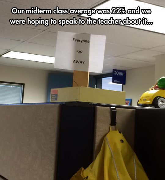 funny-picture-office-desk-sign-alone