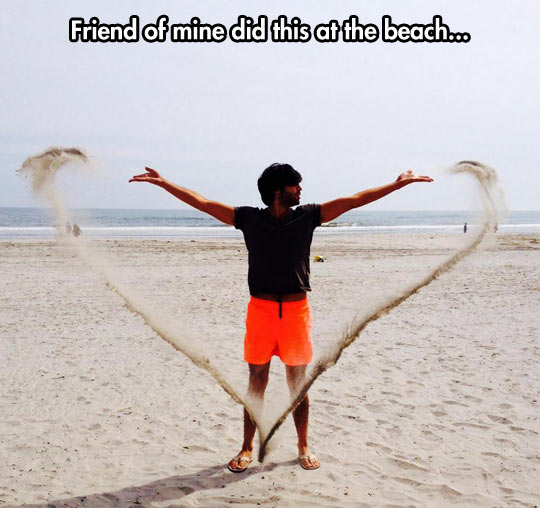 funny-picture-beach-friend-throwing-sand-heart
