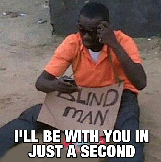 funny-picture-blind-man-street-reading-text