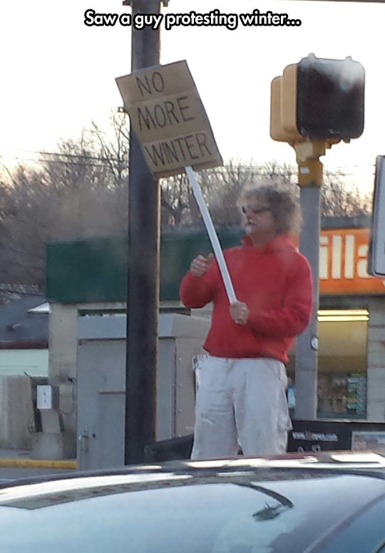 funny-picture-protester-for-winter-street-sign
