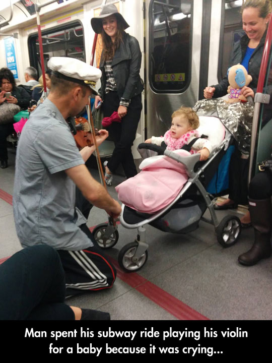 funny-picture-subway-ride-baby-violin