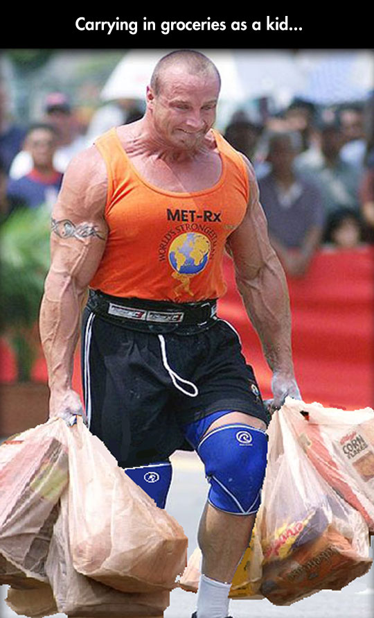 funny-picture-trong-man-carrying-groceries