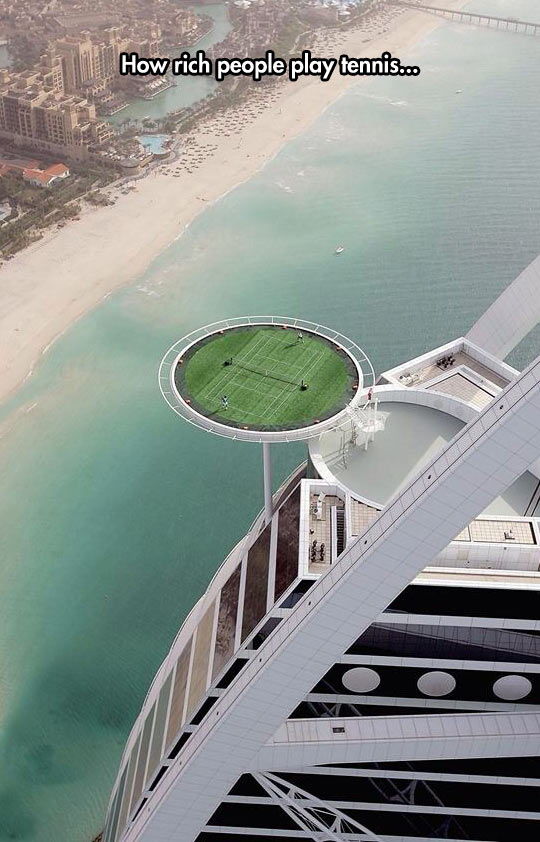 funny-tennis-court-floating-over-beach