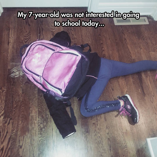 funny-kid-sleeping-behind-backpack