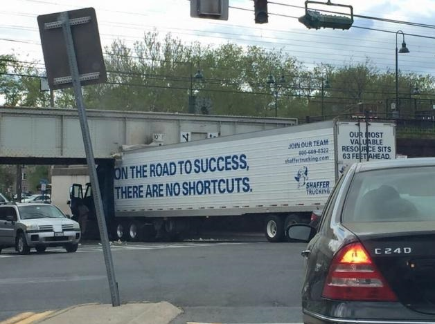 truck-fail-bridge-sign