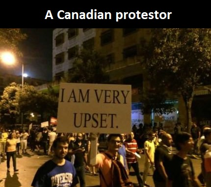 canadian-protestor-sign-upset